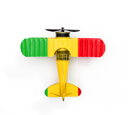National Flag of Mali travel Metal toy plane isolated on white Stock Photo