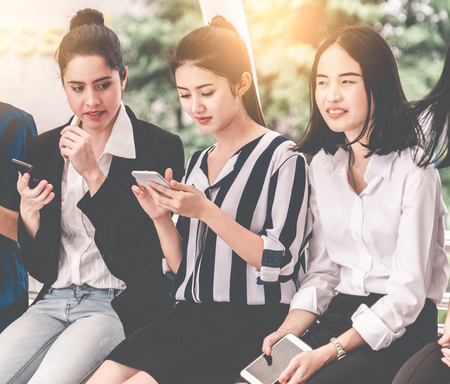 Group of young woman using digital tablet mobile phone.