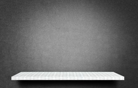Empty white shelf on gray carpet background