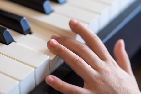 kid music performers hand playing the piano