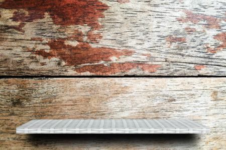 Empty wooden shelf on rustic wooden wall Stock Photo