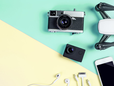 Hi tech travel gadget and accessories on blue and pink copy space Stock Photo