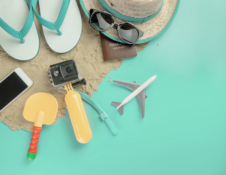 Top view of male vacations Beach fashion summer holidays accessories on pink pastel color background