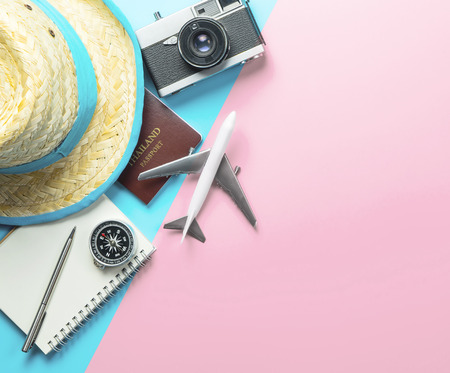 Summer Travel accessories on blue pink background copy space
