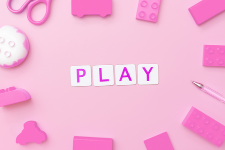Play concept with toy and objects for child education concept on pink background Stock Photo