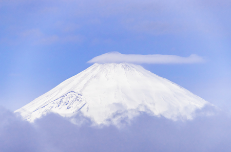 Close up top view of Fuji mountain with snow cover with could Stock Photo