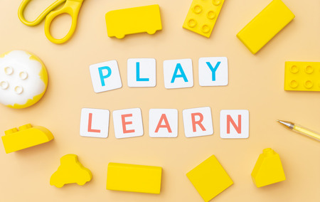 Play and Learn with toy and objects for child education concept on yellow