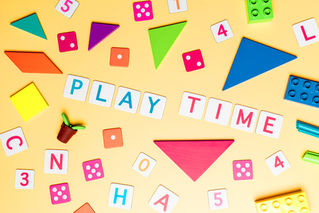Play time concept with toy and objects for child education concept on Yellow background Stock Photo