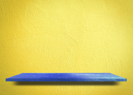 Blue wooden on yellow background product display shelf table top copy space background Stock Photo
