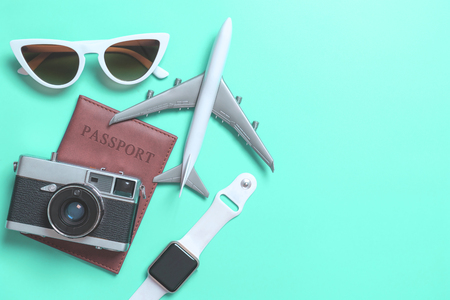 Travel accessories objects and gadgets top view flatlay on blue pastel