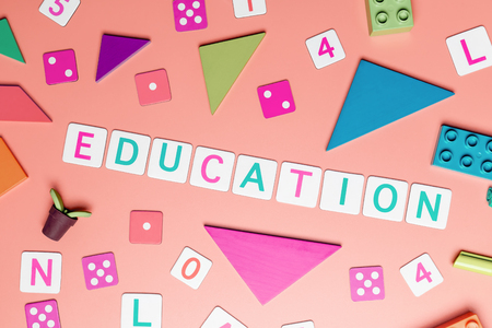 Education concept with toy and objects for child education concept on pink background