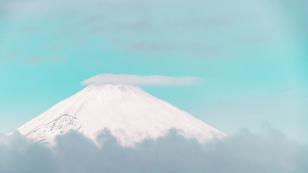 Close up top view of Fuji mountain with snow cover with could in pastel