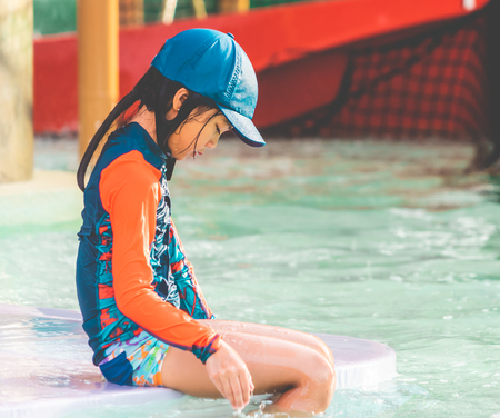 tired Little girl is sitting in swimming training pool Reklamní fotografie