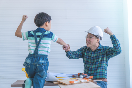 Father and Son fist bump for success concept in construction industry concept.