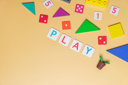 Play with toy and objects for child education concept on yellow