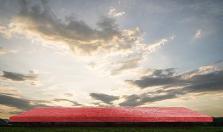 Empty red shelf on golden sky background Reklamní fotografie