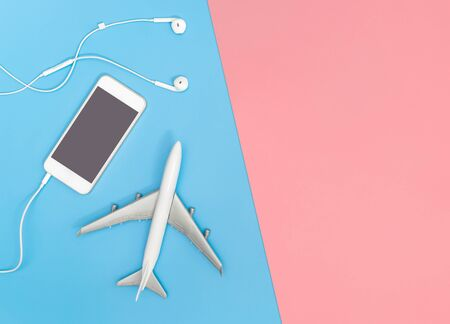 Mobile phone and plane on blue yellow pink background for Music travel