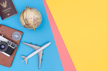 Travel accessories objects and gadgets top view flatlay on blue yellow pink Reklamní fotografie