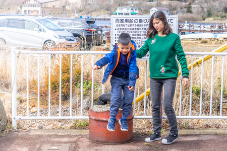 Hakone, Japan: March 26, 2019: Mother and Son is playing near Ashi Lake in Hakone, Japan