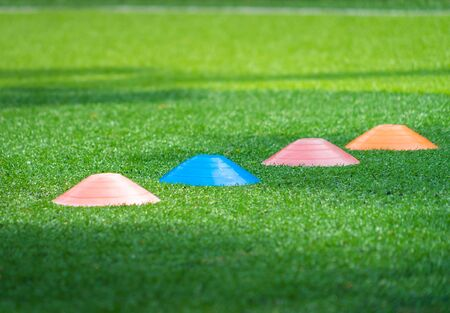 Soccer sport training equipments on green outdoor soccer training field Stok Fotoğraf