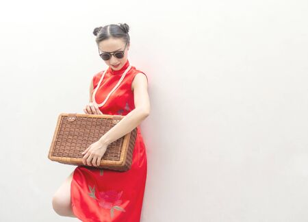 Vintage Chinese fashion model with sunglasses and travel luggage for travel concept on white background