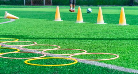 Soccer sport training equipments on green outdoor soccer training field