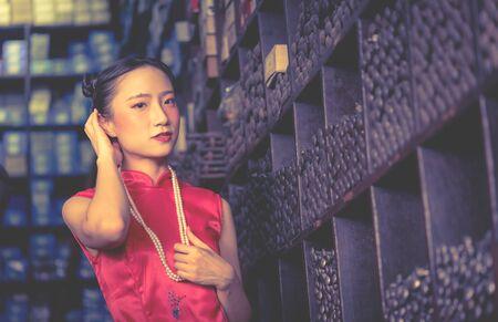 Chinese teenager seller worker in a steel metal store shop