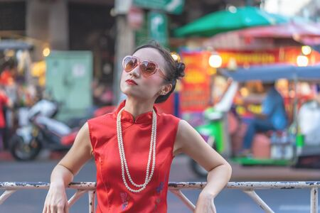Chinese Model is standing on the street of Bangkok China Town Stock fotó