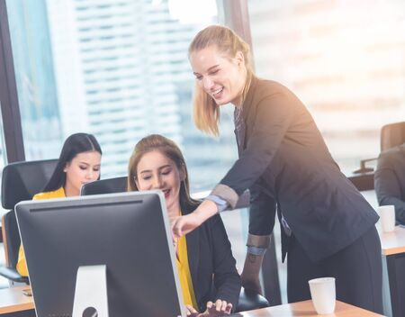 Female Manager boss is helping and teaching her officer in office