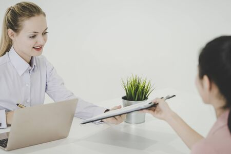 Woman is giving resume document to office in job interview