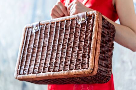 Chinese woman is holding a wooden suitcase for vintage oriental travel concept Stock fotó