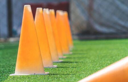 Soccer sport training equipments on green outdoor soccer training field Imagens