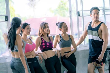 Young Group of healthy friends is working out in Fitness Gym Stock Photo