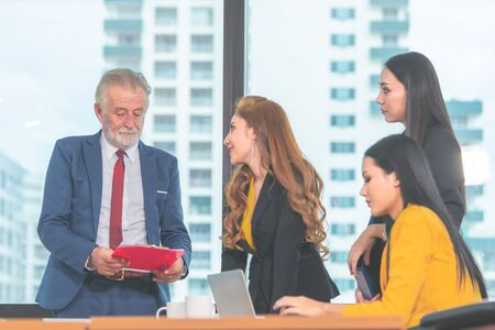 Manager boss is helping and teaching her officer in office Stock Photo