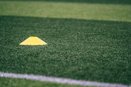 Soccer sport training equipments marker on green outdoor soccer training field Stockfoto