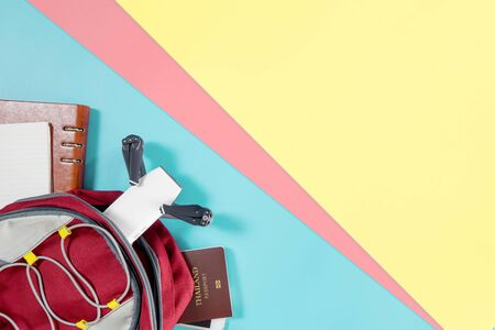 Packing Documents and gadgets for world travel top view flatlay on colorful copy space