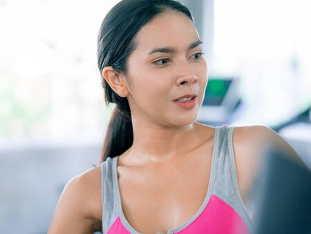 Healthy Woman body is sweating while they exercising in Fitness Gym Stock Photo