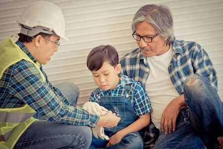 Little boy is learning from his construction Multi generation family for Family togetherness and family bonding concept. Stock Photo