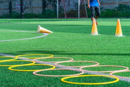 Soccer sport training equipments agility loop ladder on green outdoor Football Academy training field