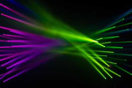 Spotlight Disco and stage light beam in green and purple for abstract backdrop and background blur line party and clubbing concept Stok Fotoğraf