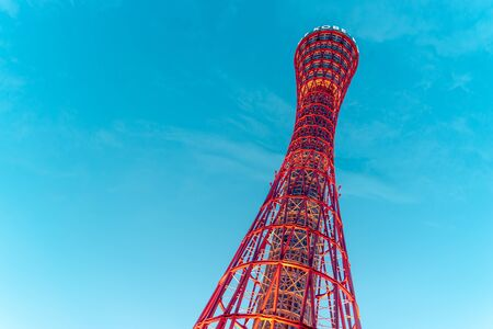 The Red Kobe Port Tower view from the base, Kansai Japan with blue teal sky. Japan tourist travel landmark. Stok Fotoğraf
