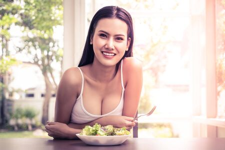 Portrait of a beautiful woman eating healthy vegetable salad for healthy and beauty lifestyle at home for healthy lifestyle concept.