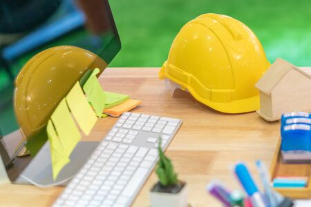 Engineer Construction contractor house builder object on office desk with computer for modern house developer construction conctractor concept. Stok Fotoğraf