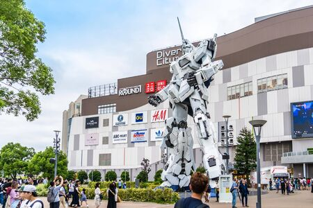 Tokyo, Japan - 22 Sep 2019 : People are taking photo of the Gundam Robot attraction in Odaiba, Tokyo.