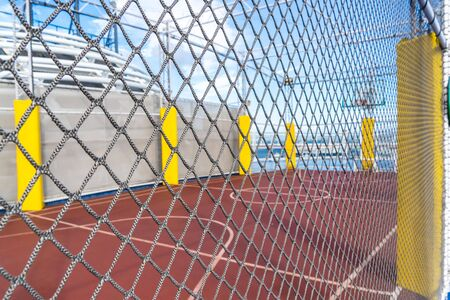 Basket Ball court with mesh wire protection with blue background for street city sport active concept background and backdrop. Stockfoto - 133466205