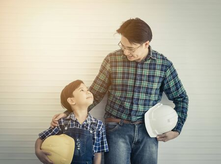 Builder Father is talking to his son for future career and teaching profession skill for his son, For Family future education concept.