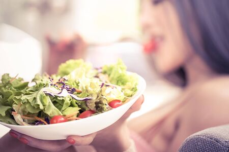 Beauty and healthy woman is having vegetable salad at home for Beauty and healthy eating for woman concept.