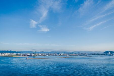 The view of Takamatsu Bay and City while the sun is setting.