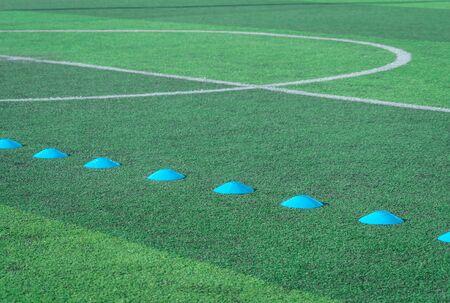 Blue sport Marker on green artificial grass soccer football pitch