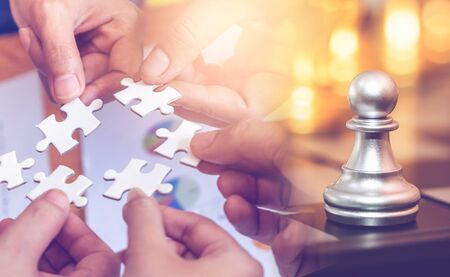 Jigsaw and chess game for business success strategy planning concept.